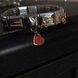 Nomination bracelet with many charms
